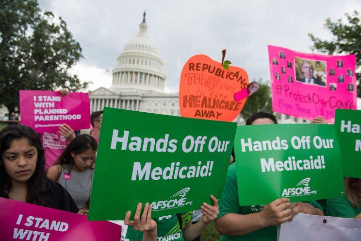 Supporters of Planned Parenthood protest the Senate Republicans' health care bill outside the Capitol in Washington, D.C.