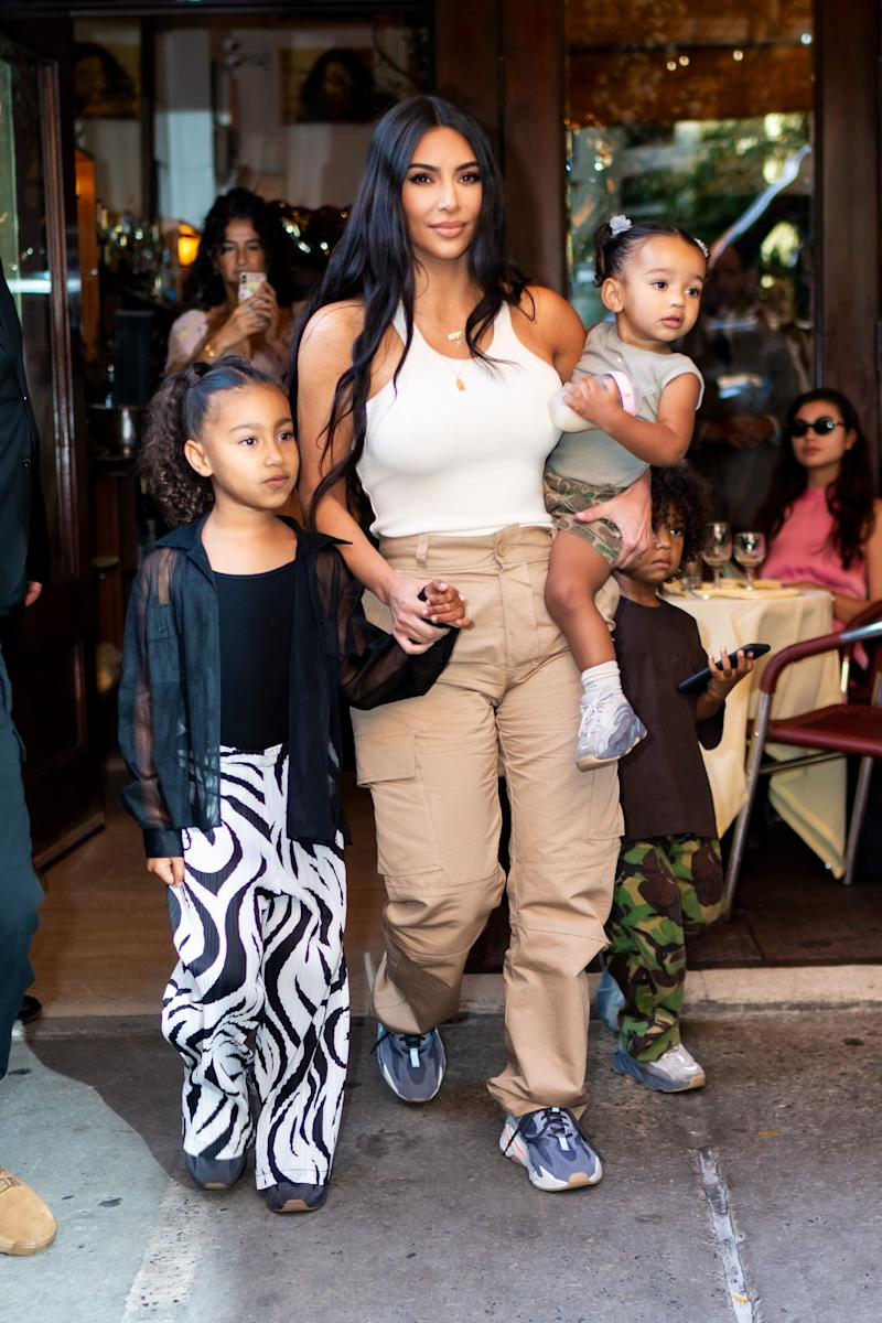 Kim Kardashian with North West and Chicago in the street