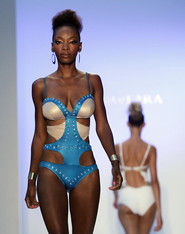 A model wears swimwear from the collection of Aqua di Lara during the Mercedes-Benz Fashion Week Swim 2013 show, Saturday, July 21, 2012, in Miami Beach, Fla. (AP Photo/Lynne Sladky)