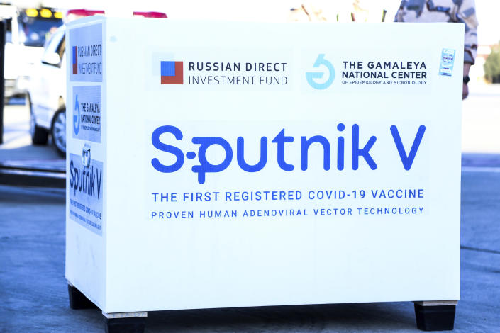 In this photo released by Imam Khomeini Airport City, Russian-made Sputnik V coronavirus vaccines are unloaded at the Tehran's Imam Khomeini International Airport, Thursday, Feb. 4, 2021. Iran on Thursday received its first batch of foreign-made coronavirus vaccines as the country struggles to stem the worst outbreak of the pandemic in the Middle East. (Saeed Kaari/IKAC via AP)