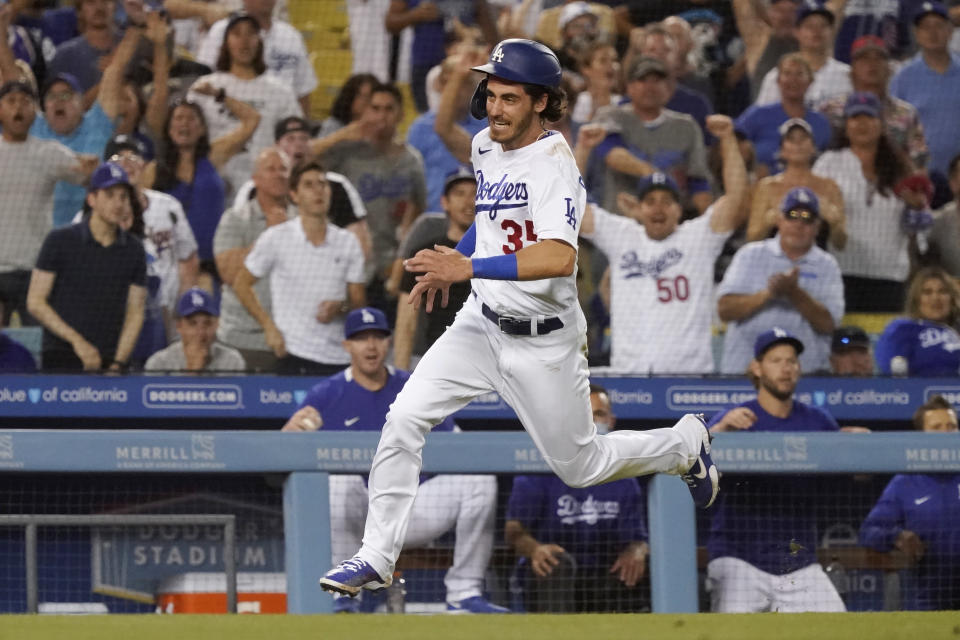 Los Angeles Dodgers' Cody Bellinger rounds third base to score on a double by AJ Pollock during the fourth inning of the team's baseball game against the San Francisco Giants on Wednesday, July 21, 2021, in Los Angeles. (AP Photo/Marcio Jose Sanchez)