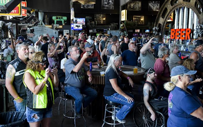 People watch a concert at the Full Throttle Saloon during the 80th Annual Sturgis Motorcycle Rally - Michael Ciaglo/Getty Images