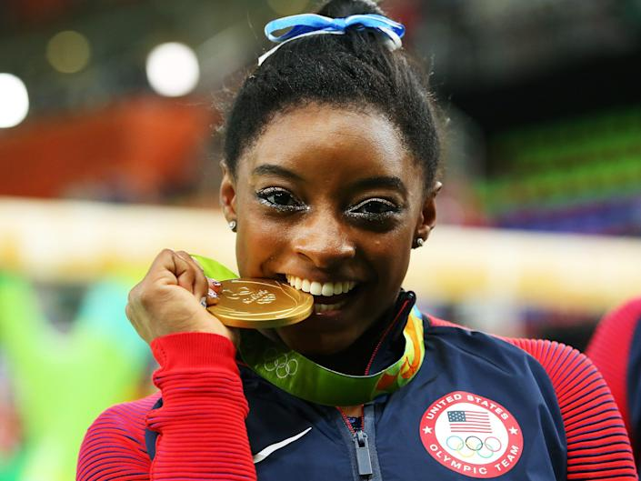 Gold medalist Simone Biles of the United States poses for photographs after the medal ceremony for the Women's Individual All Around on Day 6 of the 2016 Rio Olympics at Rio Olympic Arena on August 11, 2016 in Rio de Janeiro, Brazil.