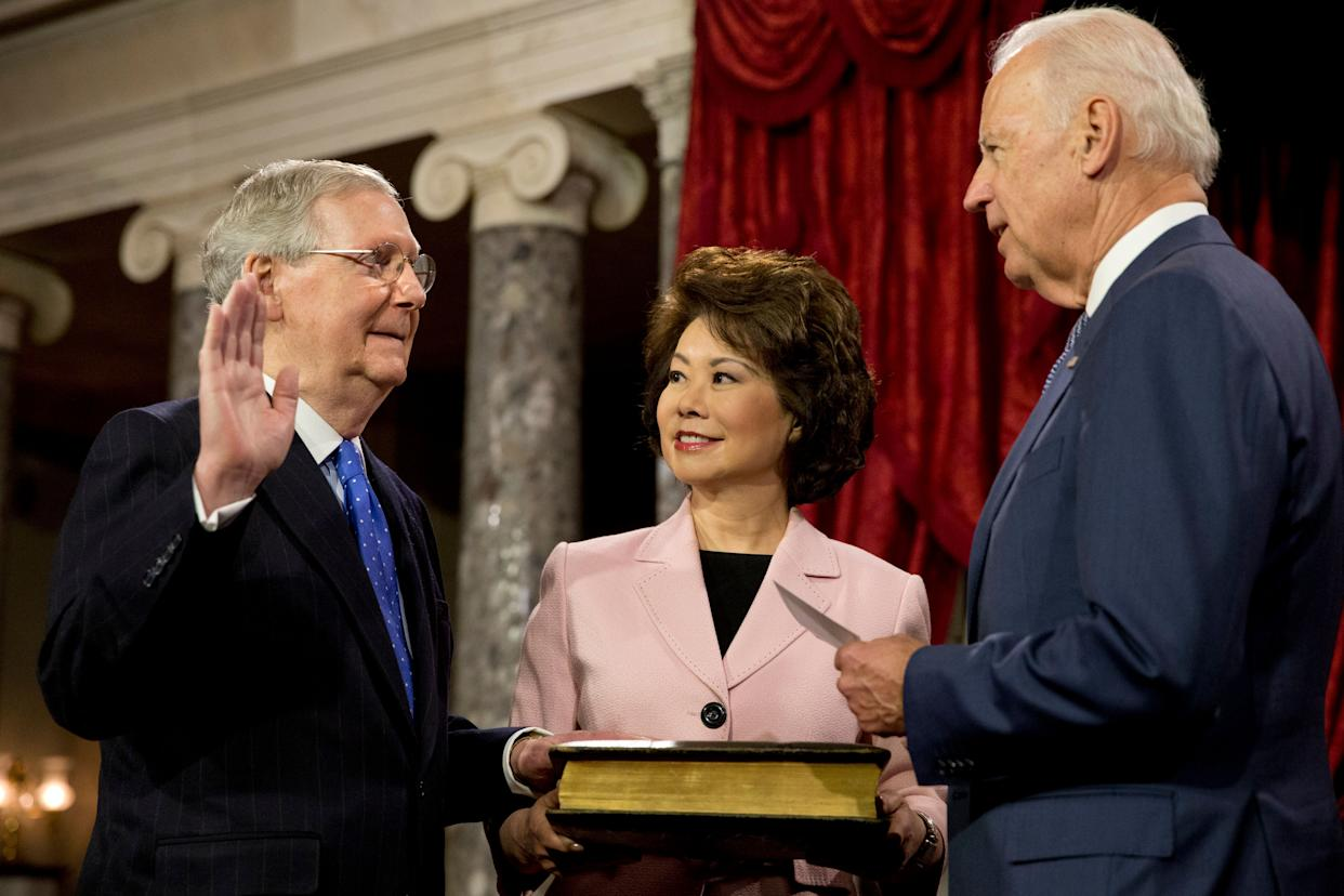 When Senate Majority Leader Mitch McConnell won reelection in 2014, it was left to then-Vice President Joe Biden to swear him in. If Biden wins the presidency, McConnell will be his biggest obstacle to policy victories. (Photo: ASSOCIATED PRESS)