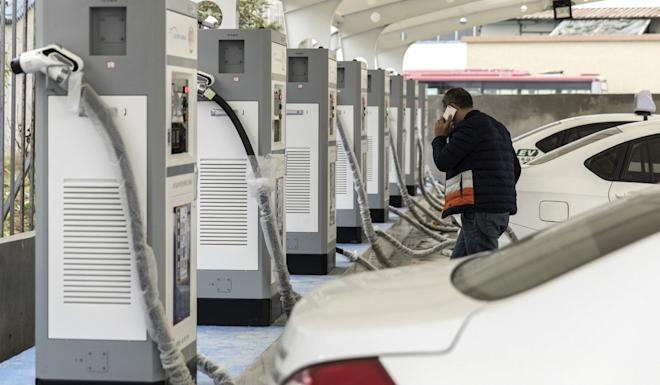 Electric taxis stand at a charging station operated by an electric vehicle dealership in Ningde, Fujian province. Photo: Bloomberg