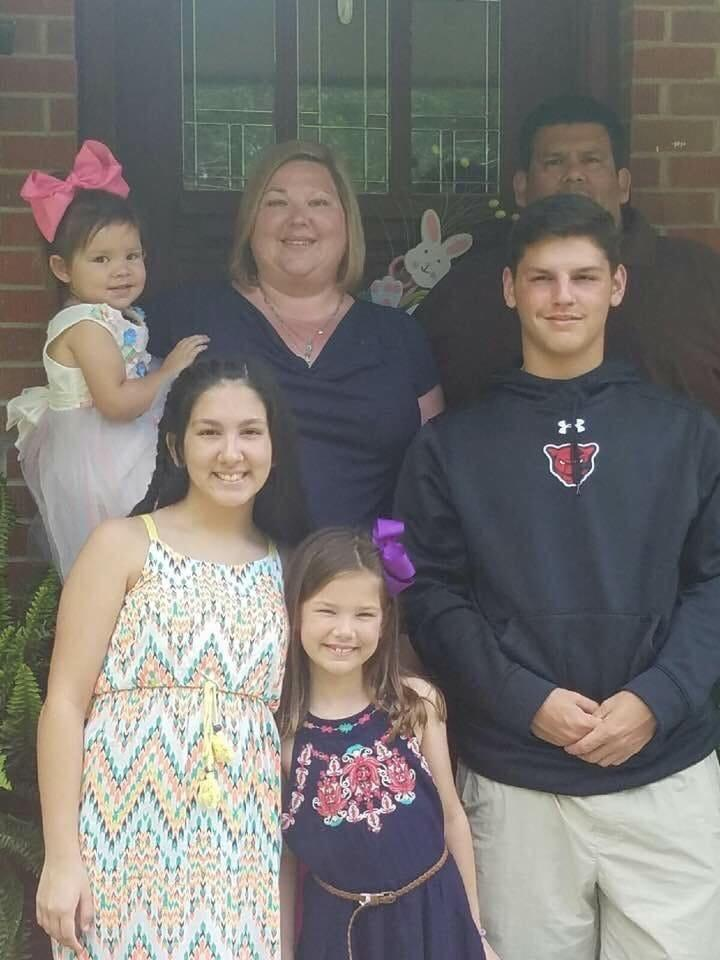 Miguel Martinez, upper right, is shown here with his family: Devin, 19 (black sweatshirt), and, clockwise, Layla, 10, Alexis, 17, Alayna, 6, and his wife, Melissa.