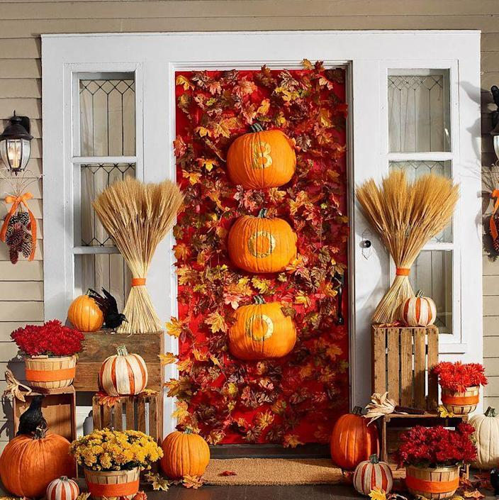 """<p>This pretty display sets the tone for a harvest-style holiday. Stenciled, halved <a href=""""http://www.funkins.com/"""" rel=""""nofollow noopener"""" target=""""_blank"""" data-ylk=""""slk:Fun-Kins"""" class=""""link rapid-noclick-resp"""">Fun-Kins</a> anchor a cascade of <a href=""""https://www.amazon.com/CrazyHomeDecor-Artificial-Garland-Wedding-Decoration/dp/B01FN65SL6/ref=sr_1_7?keywords=Artificial+Red+Maple+Vine+Fall+Colored+Leaves+Garland&qid=1563290213&s=home-garden&sr=1-7&tag=syn-yahoo-20&ascsubtag=%5Bartid%7C10070.g.2488%5Bsrc%7Cyahoo-us"""" rel=""""nofollow noopener"""" target=""""_blank"""" data-ylk=""""slk:maple leaf garlands"""" class=""""link rapid-noclick-resp"""">maple leaf garlands</a>. Add potted mums in <a href=""""https://www.amazon.com/Texas-Basket-Company-Shallow-Bushel/dp/B0195UG7QQ?tag=syn-yahoo-20&ascsubtag=%5Bartid%7C10070.g.2488%5Bsrc%7Cyahoo-us"""" rel=""""nofollow noopener"""" target=""""_blank"""" data-ylk=""""slk:apple baskets"""" class=""""link rapid-noclick-resp"""">apple baskets</a> and sugar pumpkins striped with dried corn husks for a front door that will last into Thanksgiving.</p><p><strong>1.</strong> Use a utility knife to halve two Fun-Kins lengthwise.<br></p><p><strong>2.</strong> Print and cut out stencils for the word BOO.</p><p><strong>3. </strong>Trace each letter onto a halved Fun-Kin with a pencil.</p><p><strong>4.</strong> Use small paintbrush to apply gold enamel paint inside lines; let dry.</p><p><strong>5.</strong> Hang on door with Command wire hooks .</p><p><strong>What You'll Need: </strong><a href=""""http://www.funkins.com/"""" rel=""""nofollow noopener"""" target=""""_blank"""" data-ylk=""""slk:Fun-Kins"""" class=""""link rapid-noclick-resp"""">Fun-Kins</a> ($18, funkins.com); <a href=""""https://www.amazon.com/Texas-Basket-12-5-Half-Bushel/dp/B009T7VPJA?tag=syn-yahoo-20&ascsubtag=%5Bartid%7C10070.g.2488%5Bsrc%7Cyahoo-us"""" rel=""""nofollow noopener"""" target=""""_blank"""" data-ylk=""""slk:Bushel baskets"""" class=""""link rapid-noclick-resp"""">Bushel baskets</a> ($13, amazon.com)</p>"""