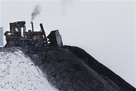 A bulldozer spreads processed coal at the Century Mine near Beallsville