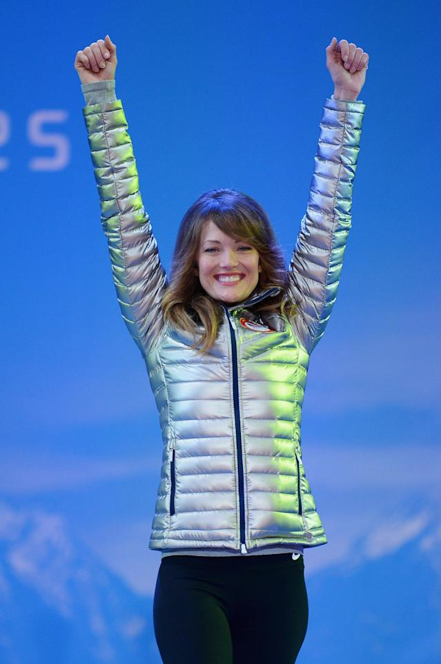 SOCHI, RUSSIA - MARCH 14: Bronze medalist Amy Purdy of the United States celebrates during the medal ceremony for Women's Snowboard Cross Standing on day seven of the Sochi 2014 Paralympic Winter Games on March 14, 2014 in Sochi, Russia. (Photo by Dennis Grombkowski/Getty Images)