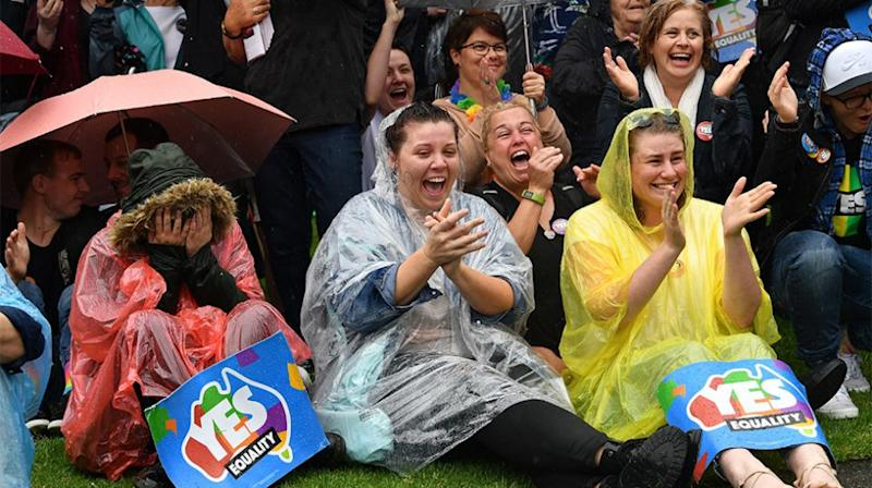 Those in Adelaide braved the weather for the announcement. Source: AAP
