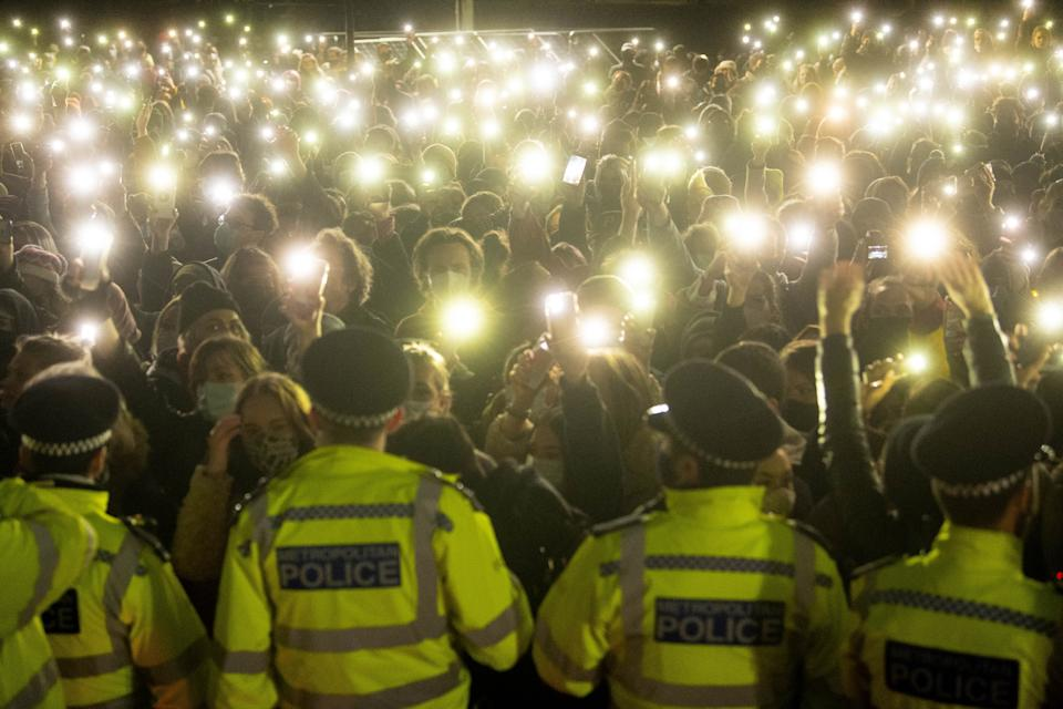 File photo dated 13/3/2021 of people in the crowd turn on their phone torches as they gather in Clapham Common, London, for a vigil for Sarah Everard. Police breached