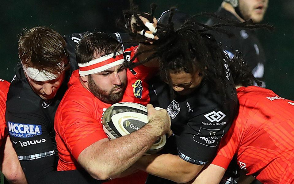 James Cronin of Munster vies with TJ Ioane of Glasgow Warriors at Scotstoun Stadium on November 23, 2020 in Glasgow, - GETTY IMAGES
