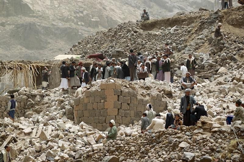Yemenis inspect the rubble of destroyed houses in the village of Bani Matar, 70 kilometers (43 miles) West of Sanaa, on April 4, 2015, a day after it was reportedly hit by an airstrike by the Saudi-led coalition