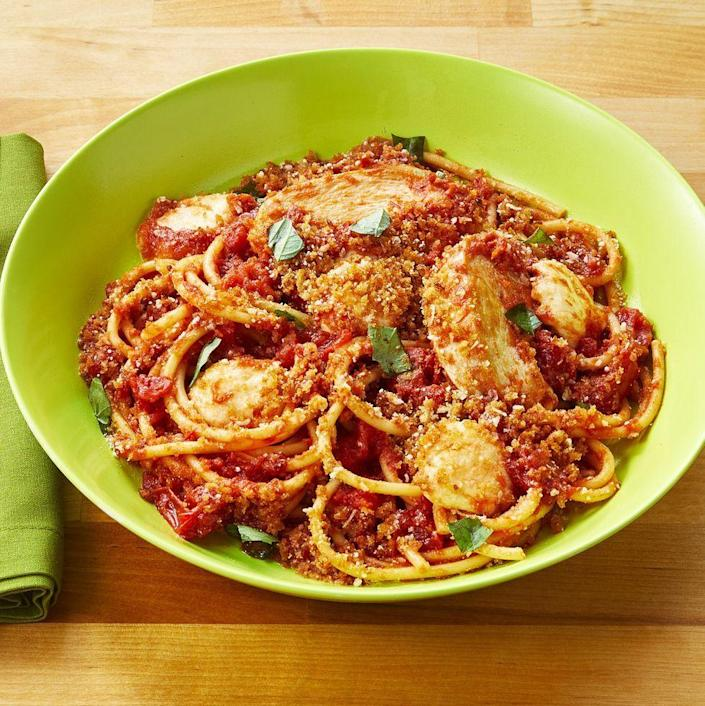 """<p>As though chicken Parm couldn't get anymore comforting, this ultra-satisfying spaghetti dish takes it to another level.</p><p><a href=""""https://www.thepioneerwoman.com/food-cooking/recipes/a34763888/chicken-parm-pasta/"""" rel=""""nofollow noopener"""" target=""""_blank"""" data-ylk=""""slk:Get the recipe."""" class=""""link rapid-noclick-resp""""><strong>Get the recipe.</strong></a></p>"""