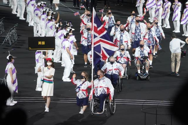Great Britain flagbearers Ellie Simmonds, left, and John Stubbs during the opening ceremony of the Tokyo 2020 Paralympic Games