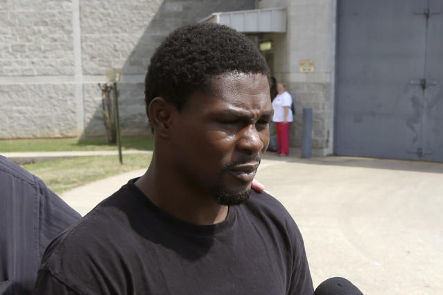 Boxer Jermain Taylor walks from the Pulaski County Jail in Little Rock, Ark., after spending the night there Wednesday, Aug. 27, 2014. A Pulaski County Sheriff's lieutenant said Taylor was arrested Tuesday, Aug. 26, on suspicion of domestic battery and aggravated assault in a shooting that wounded the former middleweight champion's cousin. (AP Photo/Danny Johnston)