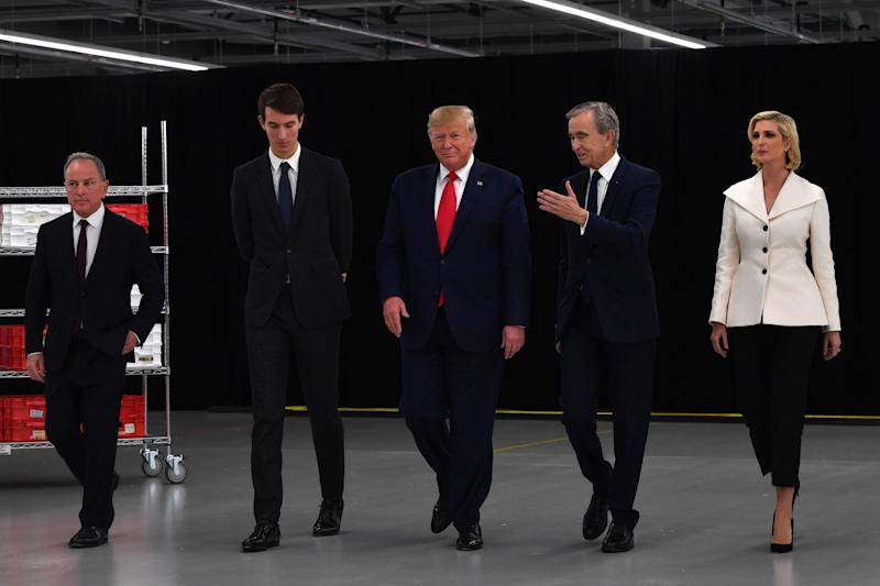 Louis Vuitton CEO Michael Burke, Jared Kushner, and Ivanka Trump joined President Trump and Arnault at the opening of Louis Vuitton Rochambeau Ranch.