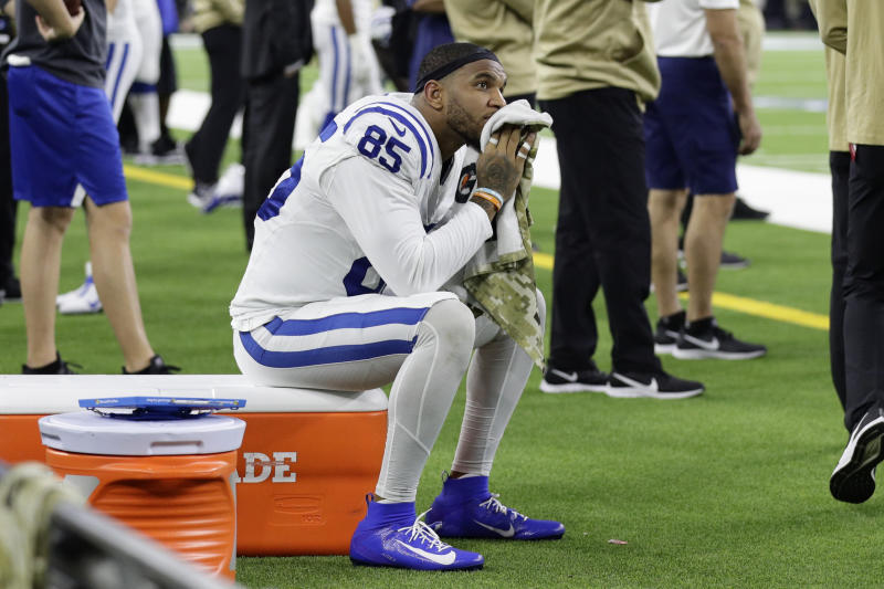 Indianapolis Colts tight end Eric Ebron (85) sits on the side lines during the final moments of the second half of an NFL football game against the Houston Texans Thursday, Nov. 21, 2019, in Houston. (AP Photo/Mike Marshall)