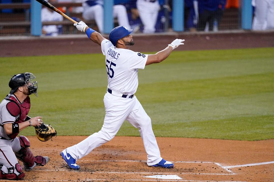 Los Angeles Dodgers' Albert Pujols hits a two-run home run against Arizona on May 20.