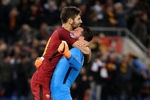 Soccer Football - Champions League Round of 16 Second Leg - AS Roma vs Shakhtar Donetsk - Stadio Olimpico, Rome, Italy - March 13, 2018 Roma's Alisson Becker celebrates with Federico Fazio after the match REUTERS/Max Rossi