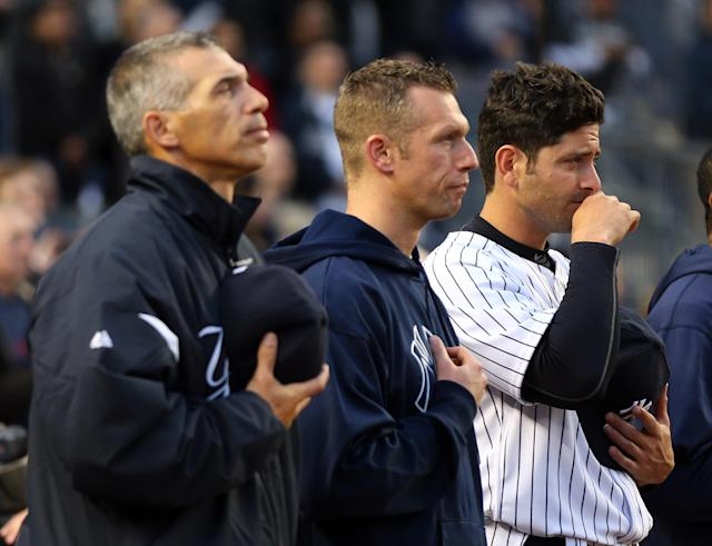 NEW YORK, NY - APRIL 16: Francisco Cervelli of the New York Yankees observes a moment of silence to honor the victims of the Boston Marathon bombing on April 16, 2013 at Yankee Stadium in the Bronx borough of New York City. All uniformed team members are wearing jersey number 42 in honor of Jackie Robinson Day. (Photo by Elsa/Getty Images)