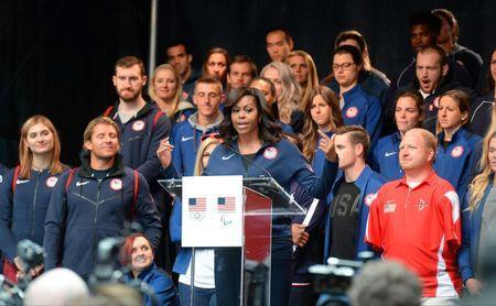 Apr 27, 2016; New York, NY, USA; First Lady Michelle Obama addresses the crowd while standing in front of U.S. athletes during the U.S. Olympic Committee 100 day countdown event to the Rio 2016 Games at Times Square. Mandatory Credit: Robert Deutsch-USA TODAY Sports