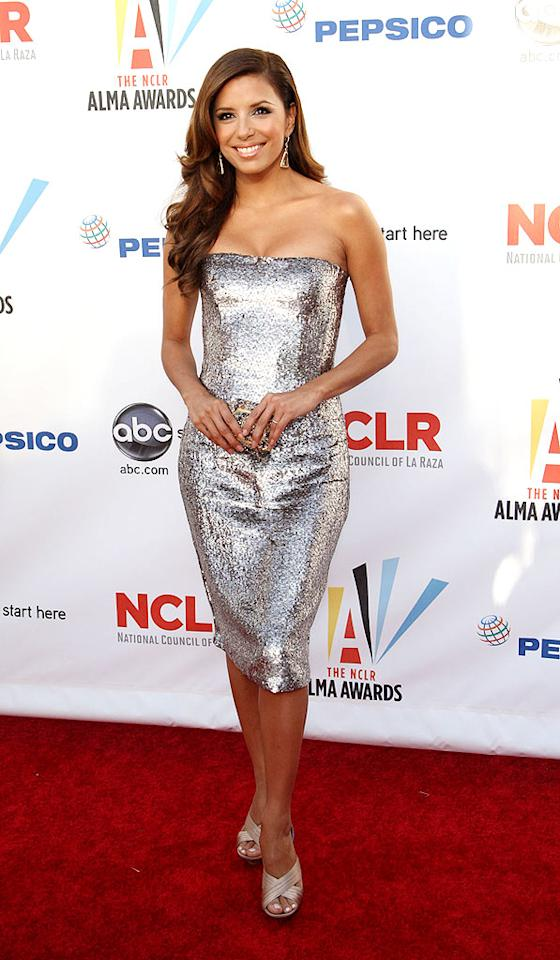 """Hostess with the mostest Eva Longoria Parker hit the red carpet at the 2009 ALMA Awards in a form-fitting sequin-adorned Oscar de la Renta strapless stunner, taupe heels, adorable curls, and minimal makeup. Frederick M. Brown/<a href=""""http://www.gettyimages.com/"""" target=""""new"""">GettyImages.com</a> - September 17, 2009"""