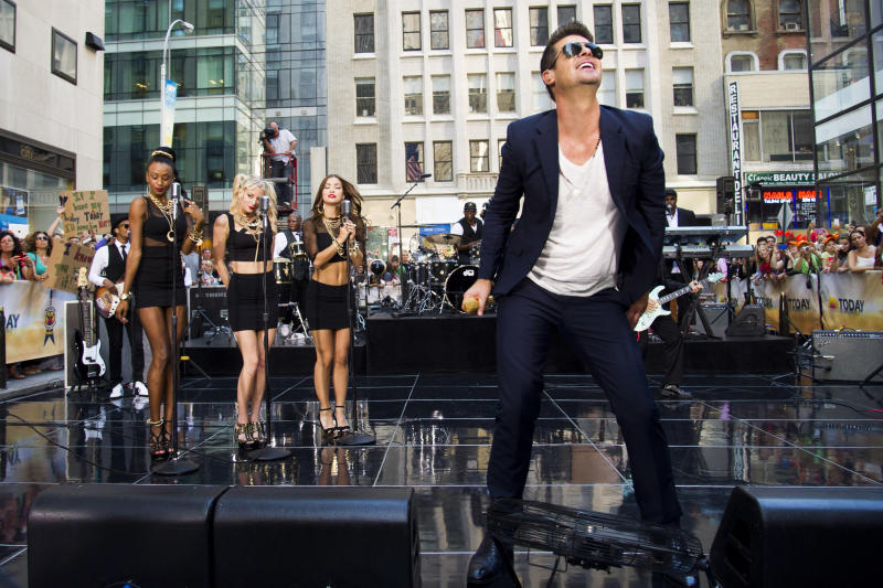"FILE - Robin Thicke performs on NBC's ""Today"" show in New York on Tuesday, July 30, 2013. The video for his song ""Blurred Lines,"" where topless models playfully dance around him, has stirred a debate, with detractors complaining that it's too racy and degrading to women. Thick insists he meant no offense - and the song, meanwhile, has become the No. 1 hit of the summer. (Photo by Charles Sykes/Invision/AP)"