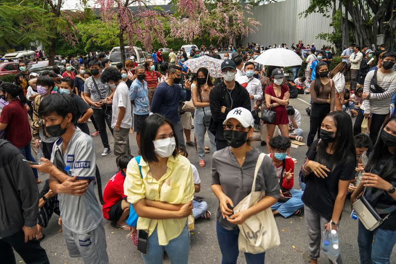 Local residents queue for a COVID-19 nasal swab test in Bangkok