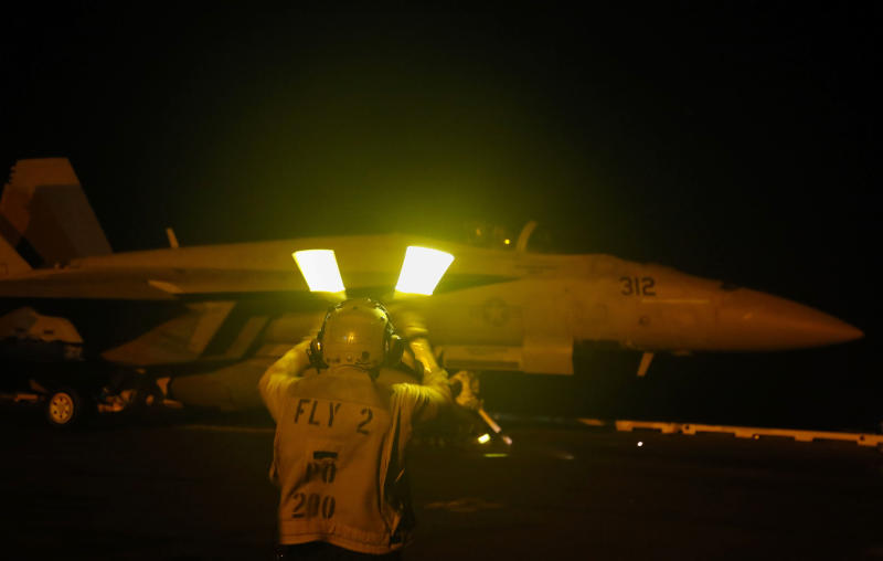 In this Friday, May 10, 2019 photo released by the U.S. Navy, an F/A-18E Super Hornet aircraft gets ready to launch from the flight deck the Nimitz-class aircraft carrier USS Abraham Lincoln in the  Persian Gulf. The  aircraft carrier strike group is being deployed to the Persian Gulf to counter an alleged but still-unspecified threat from Iran. (Mass Communication Specialist Seaman Michael Singley, U.S. Navy via AP)