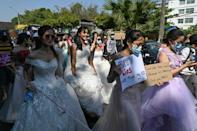 Women wore wedding gowns and displayed jokes about husbands