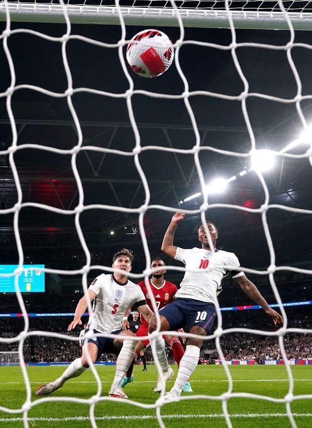 England's John Stones scores their side's first goal