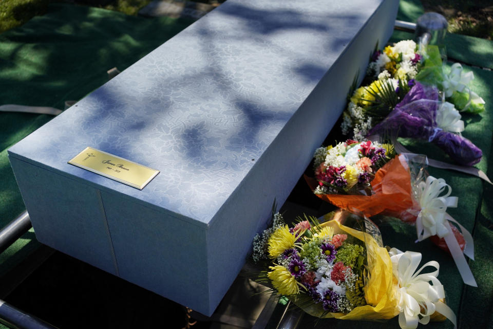 The casket of James Brown sits atop its resting place at a cemetery in the Staten Island borough of New York, Thursday, June 17, 2021. Brown was buried with three others who died during the coronavirus pandemic and were being stored at a temporary morgue in Brooklyn. The facility is out of sight and mind for many as the city celebrates its pandemic progress but stands as a reminder of the loss, upheaval and wrenching choices the virus inflicted in one of its deadliest U.S. hotspots. (AP Photo/Seth Wenig)