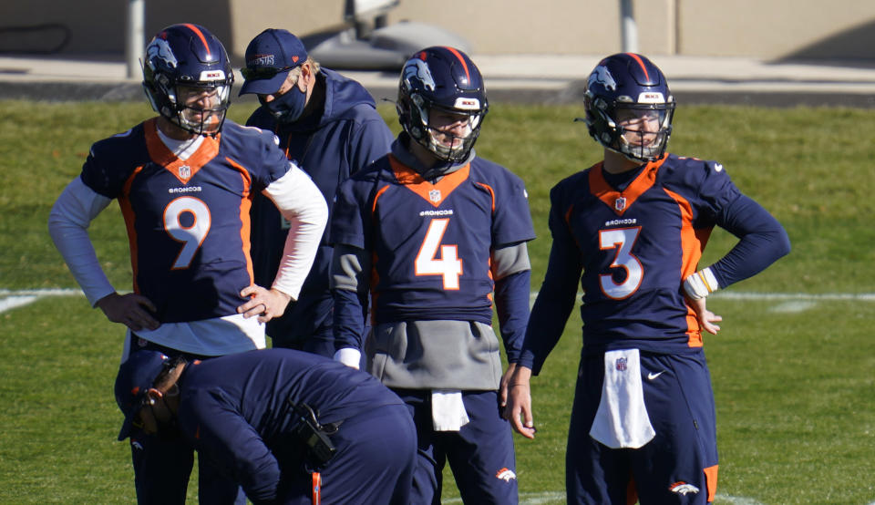 Denver Broncos quarterbacks Drew Lock, Brett Rypien and Jeff Driskel, from right, watch during the NFL football team's practice Wednesday, Nov. 11, 2020, in Englewood, Colo. (AP Photo/David Zalubowski)