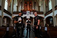 Unlike most classical concerts, both the musicians and the listening public are dressed completely in leather (AFP/John MACDOUGALL)