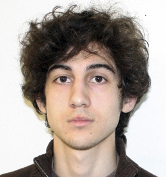 """FILE - This file photo released Friday, April 19, 2013 by the Federal Bureau of Investigation shows Boston Marathon bombing suspect Dzhokhar Tsarnaev. In court documents filed Monday, March 17, 2014, prosecutors said Tsarnaev should not be allowed to see autopsy photos that will not be used at his trial. They said allowing the man accused of killing them to see photos of their mutilated bodies """"would violate the victims' rights to dignity and privacy and subject them to needless harm and suffering."""" (AP Photo/Federal Bureau of Investigation, File)"""