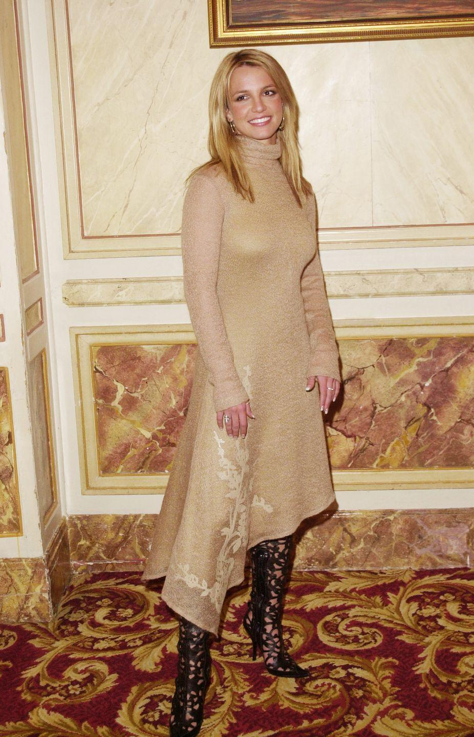 <p>Never thought a beige turtleneck dress could actually look this good, but wow, am I proved wrong. The asymmetrical hemline and laser cutout boots really make it a LOOK.</p>