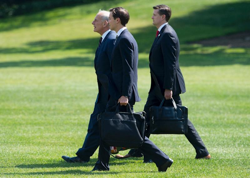 White House staff secretary Rob Porter- seen here walking to Marine One in with White House Chief of Staff John Kelly and Senior Adviser Jared Kushner- has stepped down over allegations of domestic abuse made by his ex-wives (AFP