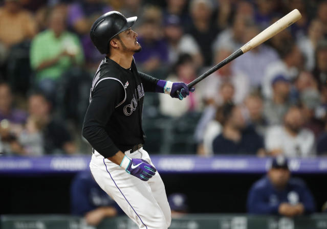 Colorado Rockies' Nolan Arenado reacts after striking out against San Diego Padres starting pitcher Joey Lucchesi during the third inning of a baseball game Friday, Sept. 13, 2019, in Denver. (AP Photo/David Zalubowski)