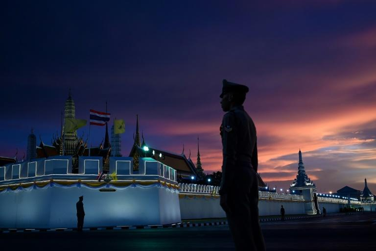 Police stand guard near the Grand Palace in Bangkok ahead of the coronation of Thailand's King Maha Vajiralongkorn