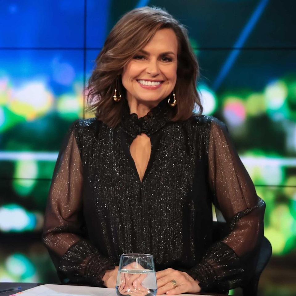 Lisa Wilkinson wearing a black dress on the set of The Project