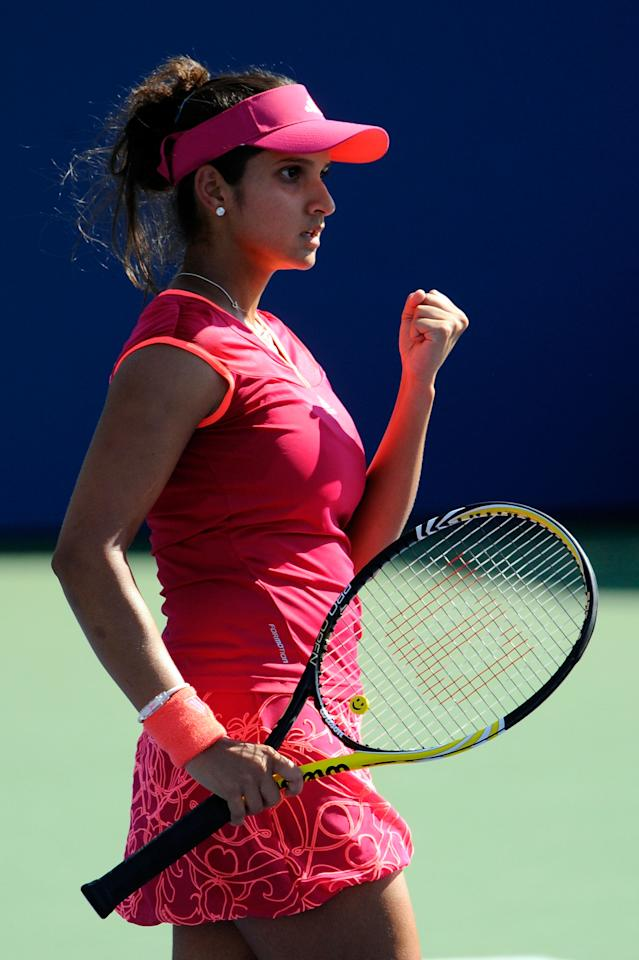 NEW YORK, NY - AUGUST 30:  Sania Mirza of India reacts to a play against  Shahar Peer of Israel during Day Two of the 2011 US Open at the USTA Billie Jean King National Tennis Center on August 30, 2011 in the Flushing neighborhood of the Queens borough of New York City.  (Photo by Patrick McDermott/Getty Images)