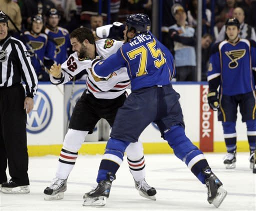 St. Louis Blues' Ryan Reaves (75) lands a punch in a fight with Chicago Blackhawks' Brandon Bollig (52) in the first period of an NHL hockey game, Tuesday, March 6, 2012 in St. Louis.(AP Photo/Tom Gannam)