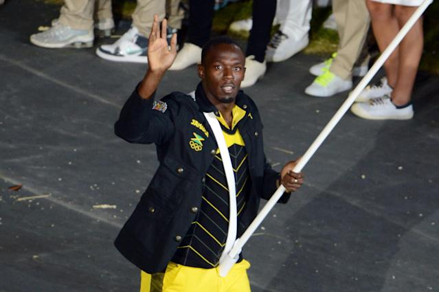 LONDON, ENGLAND - JULY 27: Reigning Olympic Men's 100m and 200m champion Usain Bolt of the Jamaica Olympic athletics team carries his country's flag during the Opening Ceremony of the London 2012 Olympic Games at the Olympic Stadium on July 27, 2012 in London, England. (Photo by Michael Regan/Getty Images)