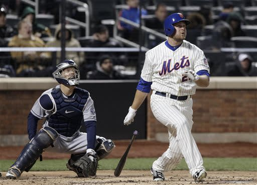 New York Mets' Lucas Duda watches his two-run home run off San Diego Padres starting pitcher Clayton Richard in the second inning of a baseball game Wednesday, April 3, 2013, in New York. Padres catcher Nick Hundley is at left. (AP Photo/Mark Lennihan)