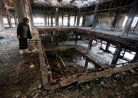 Raghad Hammoudi, who is a member of a group of students campaigning to help rebuild the Central Library of Mosul University, is seen in Mosul, Iraq May 14, 2018. Picture taken May 14, 2018.  REUTERS/Khalid Al-Mousily