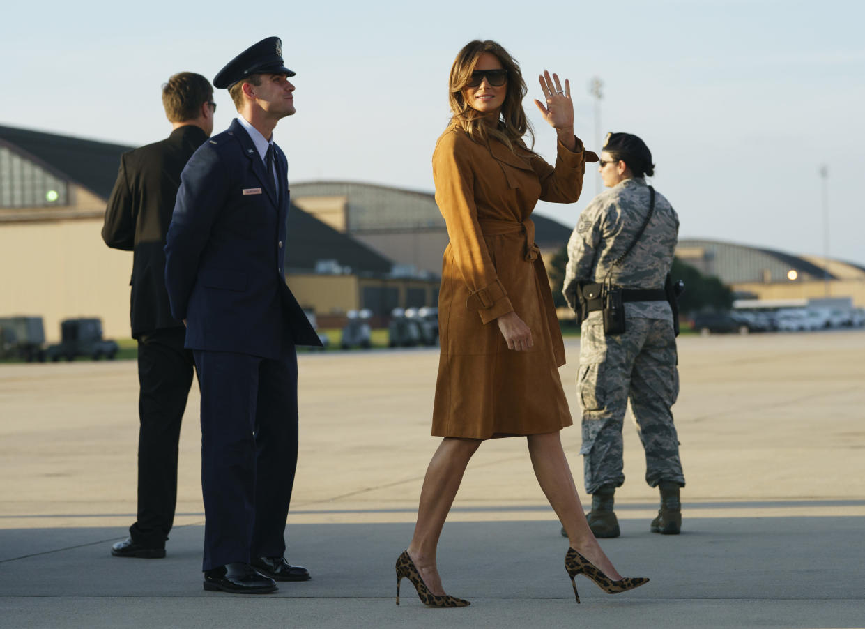 Melania Trump wore a suede coat for her trip to Ghana, Malawi, Egypt, and Kenya. (Photo: Carolyn Kaster/AP)