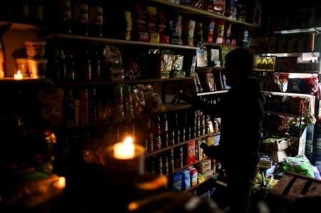 A vendor waits for customers during a national blackout, in Buenos Aires
