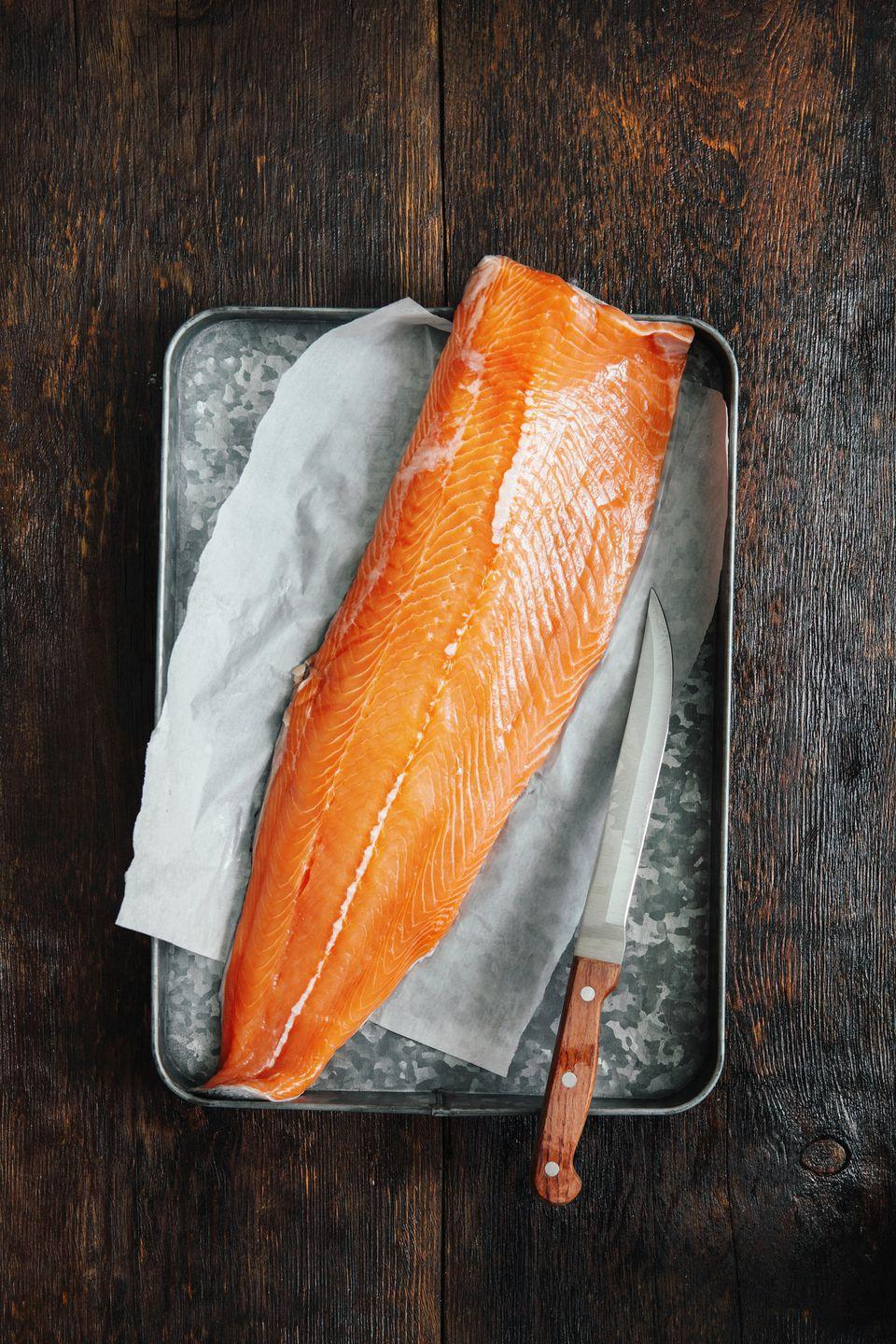 "<p>As one of nature's best sources of omega-3 fatty acids, <a href=""https://www.goodhousekeeping.com/health/diet-nutrition/a19503650/salmon-nutrition/"" rel=""nofollow noopener"" target=""_blank"" data-ylk=""slk:salmon has many health benefits"" class=""link rapid-noclick-resp"">salmon has many health benefits</a>, including reducing inflammation and triglycerides.</p><p><strong>RELATED: </strong><a href=""https://www.goodhousekeeping.com/food-recipes/healthy/g817/healthy-salmon-dinners/"" rel=""nofollow noopener"" target=""_blank"" data-ylk=""slk:16 Salmon Dinners That Are Super Healthy"" class=""link rapid-noclick-resp"">16 Salmon Dinners That Are Super Healthy</a></p>"