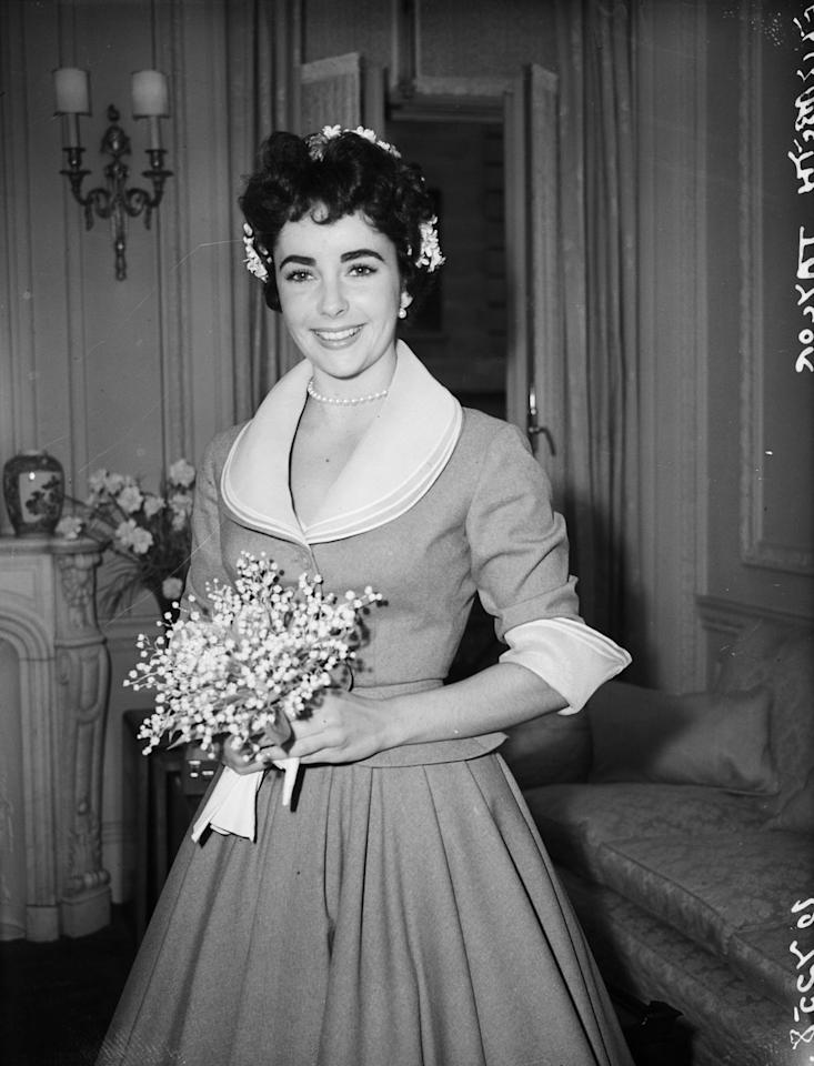 <p>While she wore several gowns for her many marriages, Elizabeth Taylor's first unconventional dress was this simple suit for her 1952 wedding to her second husband, Michael Wilding.</p>